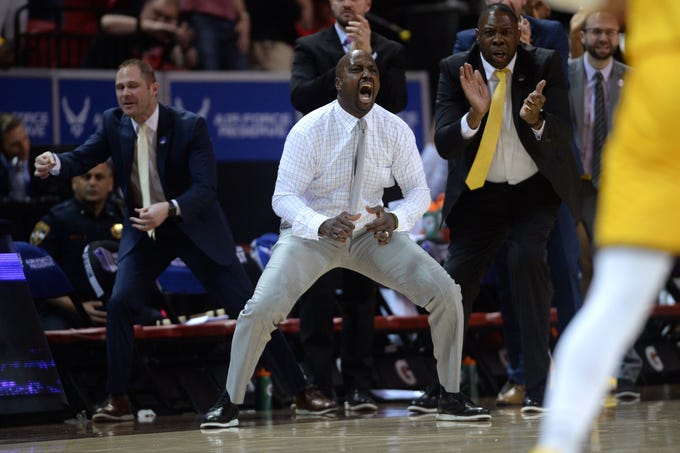 Mar 5, 2020; Las Vegas, Nevada, USA; Wyoming Cowboys head coach Allen Edwards (C) reacts from the bench after a Cowboys score during the second half of a Mountain West Conference tournament game against the Nevada Wolf Pack at Thomas Mack Center. Mandatory Credit: Orlando Ramirez-USA TODAY Sports
