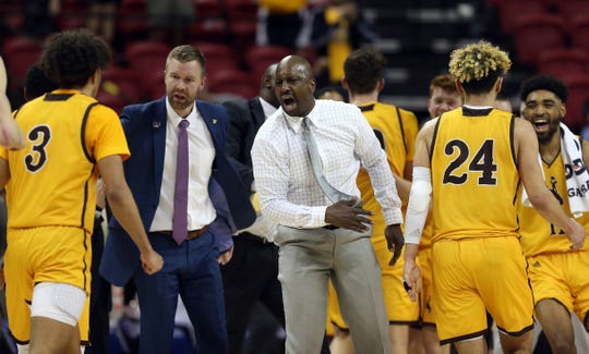 Wyoming head coach Allen Edwards congratulates his team during the second half of a Mountain West Conference tournament NCAA college basketball game against Nevada, Thursday, March 5, 2020, in Las Vegas. Wyoming defeated Nevada 74-71. (AP Photo/Isaac Brekken)