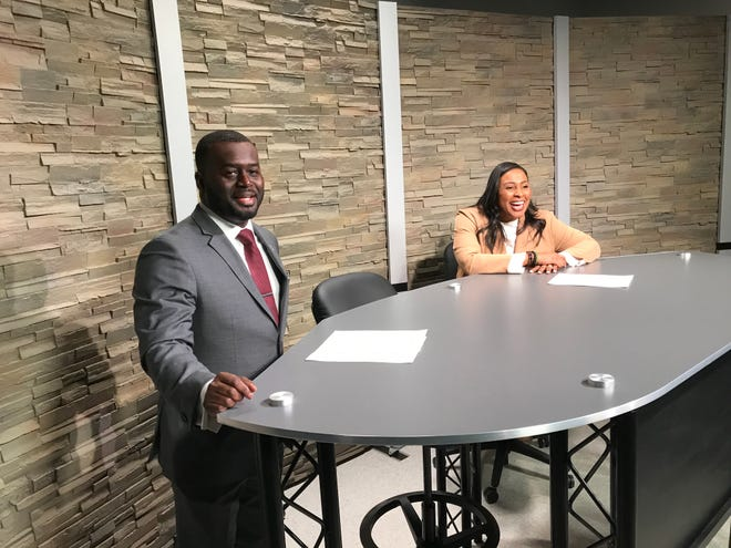 Edison Tech Principal Jacob Scott and Mayor Lovely Warren prepare for a student interview at Edison's new television production studio.