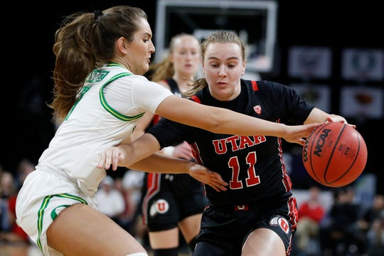 Oregon's Taylor Chavez, left, guards Utah's Brynna Maxwell (11) during the first half of an NCAA college basketball game in the quarterfinal round of the Pac-12 women's tournament Friday, March 6, 2020, in Las Vegas.