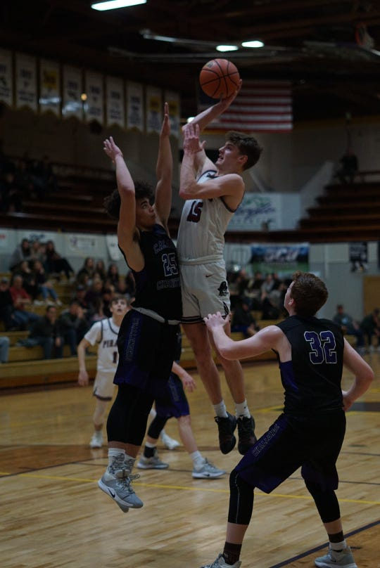 Dayton's boys basketball team competes against Cascade Christian during the state tournament on Thursday.