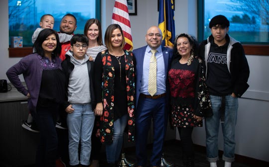 Oscar Moreno Gilson poses for a picture with his family after signing the contract for the Woodburn School District superintendent position during a special school board meeting March 5, 2020.