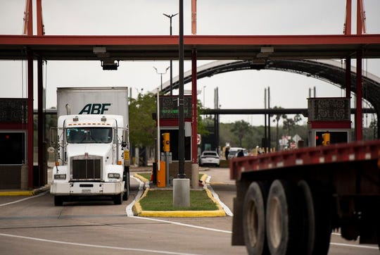 Trucks leave the United States crossing the Veterans International Bridge from Brownsville.