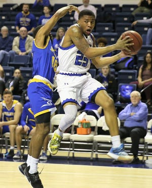 Angelo State University's Collin Turner grabs a rebound earlier in the 2019-2020 season.