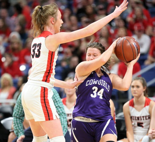 Mason High School's Jesse Armstrong is defended by Muenster's Annie Anderle during a Class 2A girls basketball state semifinal at the Alamodome in San Antonio on Friday, March 6, 2020.