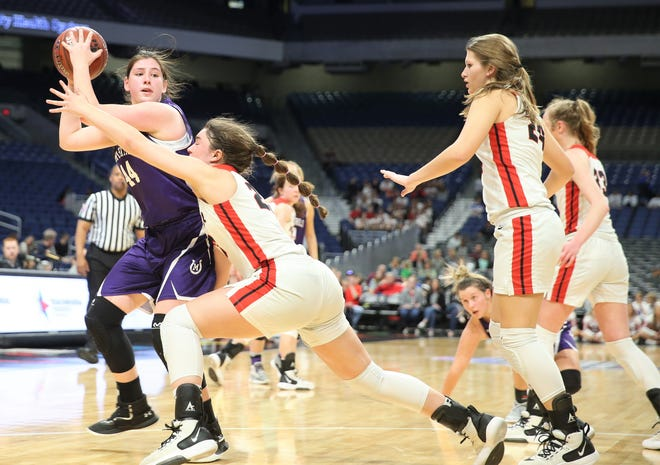 Mason High School's McKenzie Cano is swarmed by Muenster players in a Class 2A girls basketball state semifinal at the Alamodome in San Antonio on Friday, March 6, 2020.