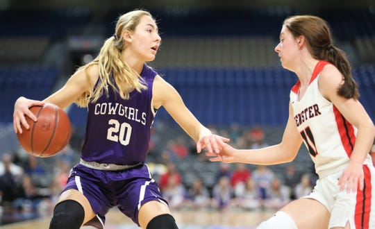 Mason High School's Tristin Keller is defended by a Muenster player during the UIL Class 2A girls basketball state semifinal at the Alamodome in San Antonio on Friday, March 6, 2020.