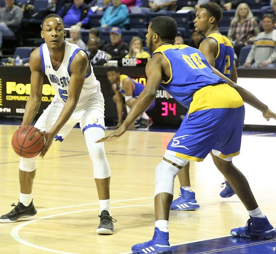 Angelo State University's Burone Edwards looks to pass the ball during a game earlier in the 2019-2020 season.