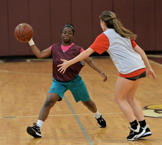 Snow Hill freshman Mariah Murray makes a pass during practice on Thursday, March 5, 2020.