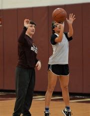 Snow Hill head coach Courtney Kief works with Lauren Moses during a shooting drill on Thursday, March 5, 2020.