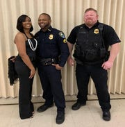 Pictured from Left to right: Cpl. LaToyia Marsden, Cpl. LaBrian Marsden, K-9 Sgt. Daniel Sawyer.
