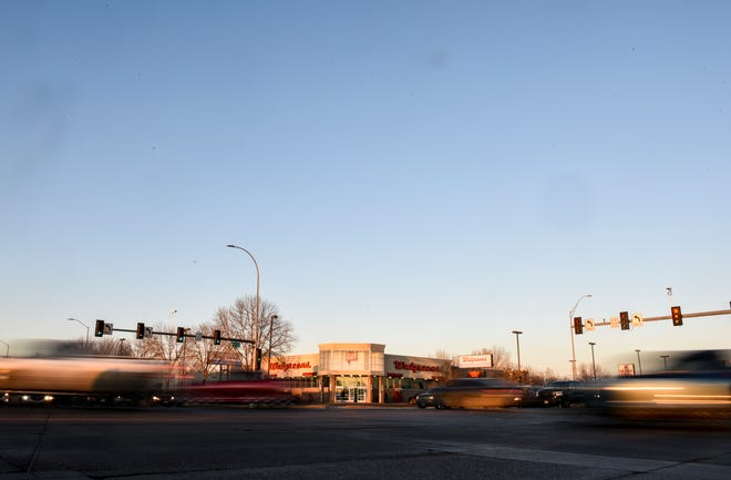 Cars drive through the intersection of 41st Street and Louise Ave on Thursday, March 5, 2020 in Sioux Falls.