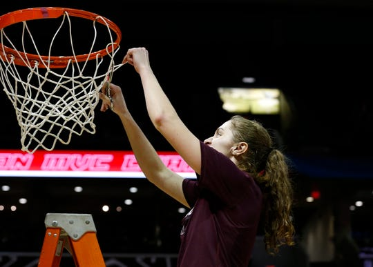 Missouri State Lady Bears guard Alexa Willard (22) cuts down the net after the Lady Bears beat the Valparaiso Crusaders 85-70 to win the Missouri Valley Conference regular-season title at JQH Arena on Thursday, March 5, 2020.
