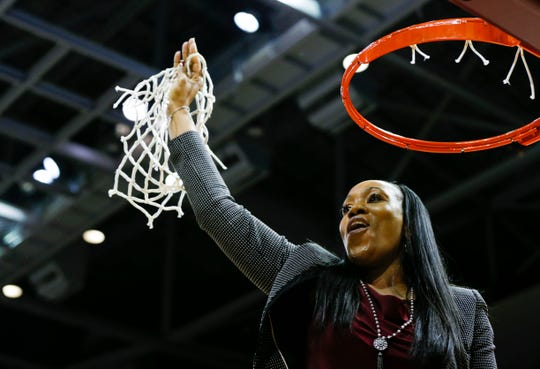 Missouri State Lady Bears head coach Amaka Agugua-Hamilton cuts down the net after the Lady Bears beat the Valparaiso Crusaders 85-70 to win the Missouri Valley Conference regular-season title at JQH Arena on March 5.