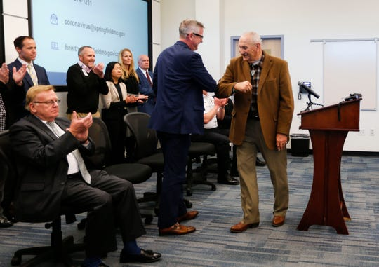 Springfield-Greene County Health Department Director Clay Goddard and County Commissioner Harold Bengsch bump elbows as an alternative to shaking hands at a press conference about the coronavirus on Friday, March 6, 2020.