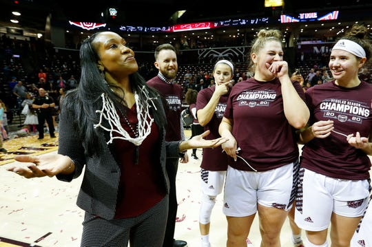 Missouri State Lady Bears head coach Amaka Agugua-Hamilton shows off the cut down net after the Lady Bears beat the Valparaiso Crusaders 85-70 to win the Missouri Valley Conference regular-season title at JQH Arena on Thursday, March 5, 2020.