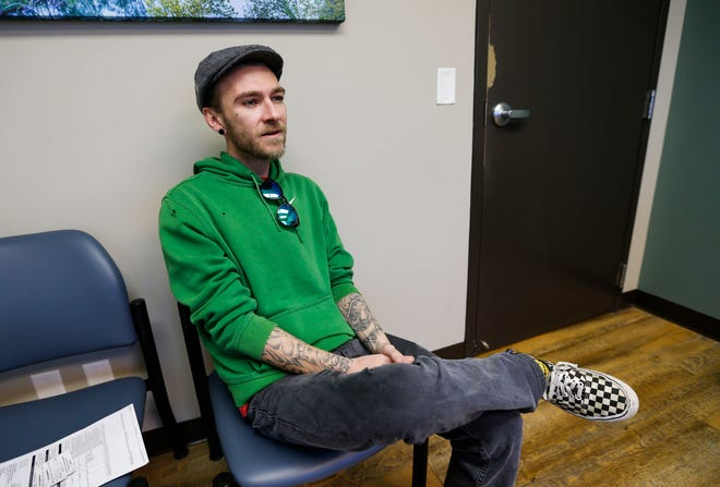 Andrew Johnson, 30, talks about his battle with heroin addiction on Monday, Feb. 17, 2020. Johnson has been seeing psychiatrist Salvador Ceniceros at Jordan Valley Community Health Center's walk-in clinic for people addicted to opioids for two years to help manage his addiction.