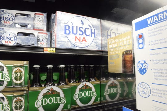 Walmart is asking customers if they would like to buy full-strength beer in store, with signs posted in the beer aisle, on checkout stands and on frozen food end-caps at the store in Sartell shown March 6, 2020.