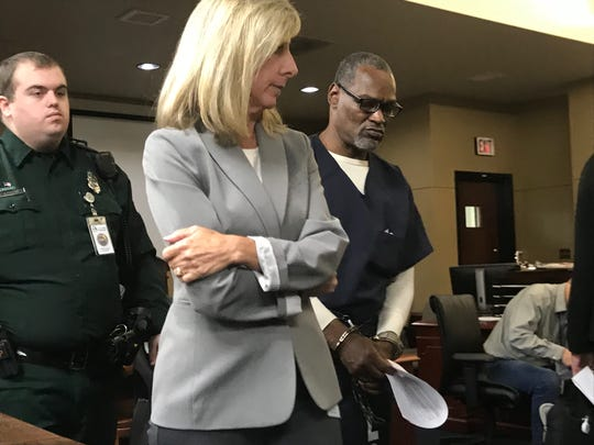 Double murderer Philip Ford is led out of a Leon County courtroom next to Assistant Public Defender Nancy Showalter after pleading no contest to two first-degree murder counts. He will serve two life sentences