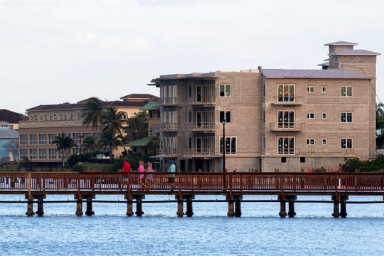 A new development, the River House, is under construction Thursday, March 5, 2020, along a stretch of the St. Lucie River in downtown Stuart. The building is one of the few tall structures in the city. Officials are considering whether four-story residential buildings belong in neighborhoods with single-family homes.