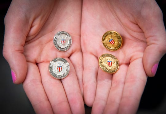Kelsey Pranke holds her four pins for her Presidential Service Awards she received in 2014 through 2017.