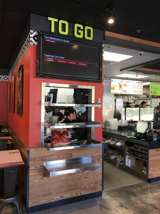 Alphabetized by diners' names, orders to go are placed on shelves to await pick up at Cafe Rio Mexican Grill in Thousand Oaks.