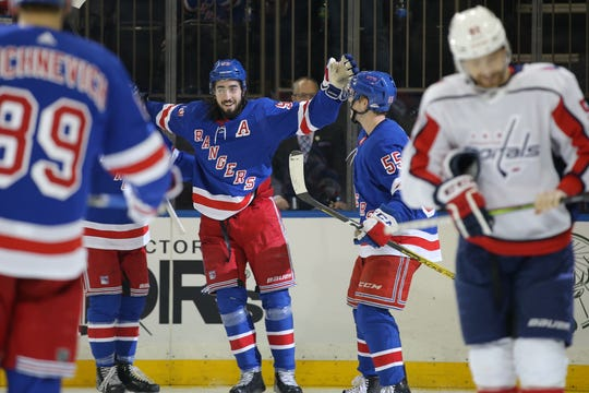 Mar 5, 2020; New York, New York, USA; New York Rangers center Mika Zibanejad (93) celebrates his goal against the Washington Capitals with teammates during the second period at Madison Square Garden. Mandatory Credit: Brad Penner-USA TODAY Sports