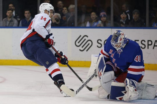 Mar 5, 2020; New York, New York, USA; New York Rangers goalie Alexandar Georgiev (40) makes a save on a breakaway shot by Washington Capitals right wing Richard Panik (14) during the first period at Madison Square Garden. Mandatory Credit: Brad Penner-USA TODAY Sports