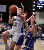 Hendrick Hudson's Caitlin Weimar shoots over Pearl River's Mary Windram during their Class A semifinal at the Westchester County Center Mar. 5, 2020. Hen Hud won 50-45.