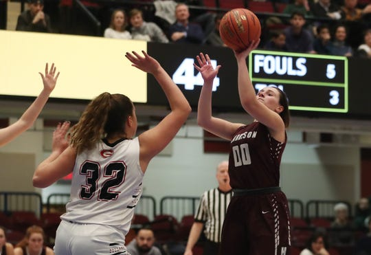 Harrison's Gabby Marraccini (00) puts up a shot late in the game against Rye during the girls  Class AA semifinal at the Westchester County Center in White Plains March 5, 2020. Harrison won the game 54-51.