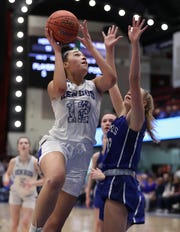 Hendrick Hudson's Caitlin Weimar shoots over Pearl River's Corinne Miedreich during their Class A semifinal at the Westchester County Center Mar. 5, 2020. Hen Hud won 50-45.