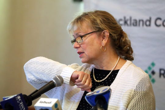 Rockland County Commissioner of Health Patricia Schnabel Ruppert demonstrates how to cough into your sleeve during a press conference at the Yeager Health Center in Pomona March 6, 2020.