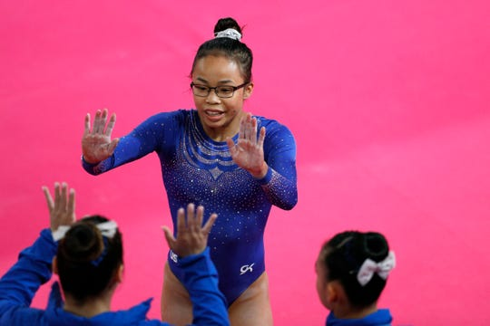 In this July 27, 2019, file photo, Morgan Hurd is congratulated by teammates after competing in the women's gymnastics qualification and team final at the Pan American Games in Lima, Peru.