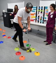 "Grad student Marcelo Campolino failed a driving intoxicated simulation while wearing ""drunk goggles"" that mimic alcohol impairment and riding a scooter at the Midwestern State University 20th annual Community Health Fair."