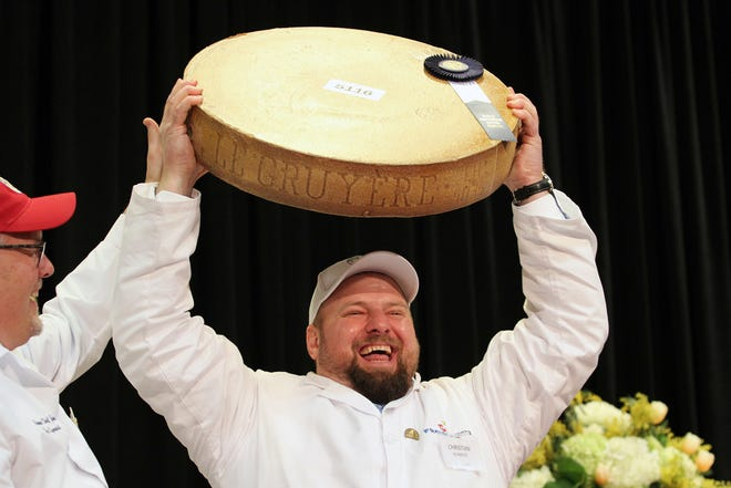 Christian Schmutz, of Switzerland, hoists the championship cheese over his head at the World Championship Cheese Contest on March 5, 2020 in Madison. The cheese, called Gourmino Le Gruyère AOP, is made by Michael Spycher of Mountain Dairy Fritzenhaus for Gourmino AG.