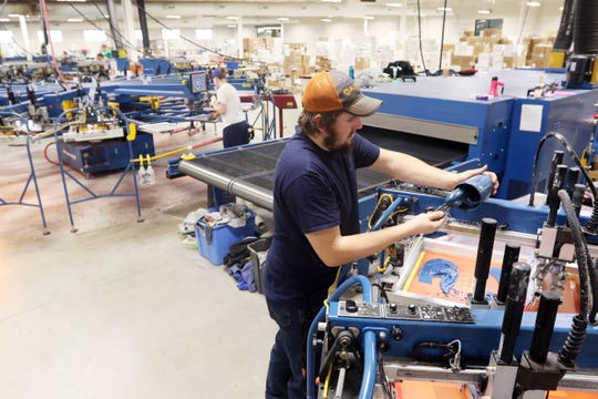 Screen printing operator Dom Foreman gets a test run ready at 5B's facility in Zanesville. The company built a 50,000-square-foot addition last year, helping Zanesville become one of the fastest growing Micropolitan areas in the country last year.