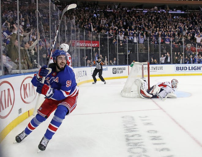 Mika Zibanejad celebrates after scoring his fifth goal of the game in overtime to defeat Ilya Samsonov 30 and the Washington Capitals 5-4 at Madison Square Garden.