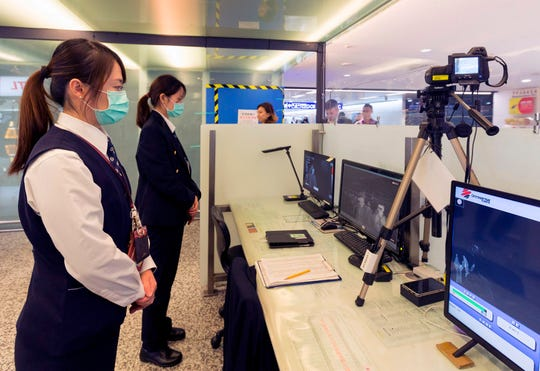 Taiwan's Center for Disease Control screens passengers arriving on a flight from Wuhan, China, in January 2020.
