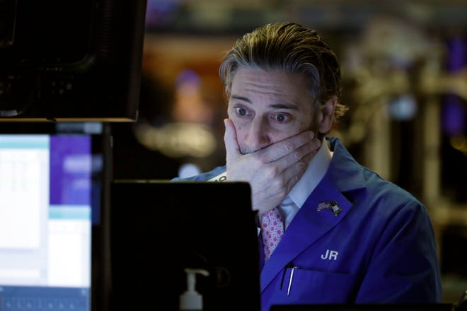 Trader John Romolo works on the floor of the New York Stock Exchange, March 5, 2020.