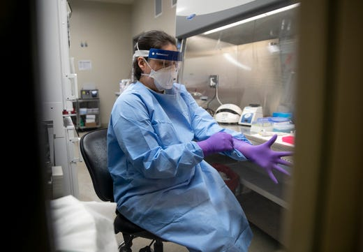 Microbiologist Chelsey Tiger tests samples for viruses in the virology lab at the Department of State Health Services Laboratory Building on Thursday March 5, 2020, where coronavirus tests will begin tomorrow.