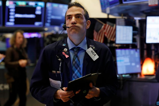 Trader Gregory Rowe works on the floor of the New York Stock Exchange on March 6, 2020.