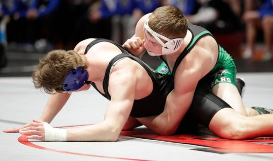Random Lake's Brock Upson wrestles Coleman's Jonathon Bieber in the 182-pound weight class Saturday during a WIAA Division 3 semifinal state wrestling match in Madison.