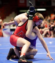 Neenah's Drake Hayward wrestles Stoughton's Braeden Whitehead in the 145-pound weight class Friday in Madison.