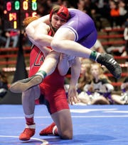 Neenah's Marshall Kools wrestles Stoughton's Luke Pugh in the 195-pound weight class Friday during the WIAA Division 1 quarterfinal state wrestling match in Madison.