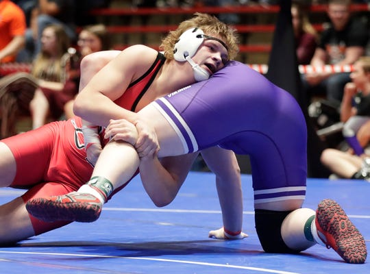 Neenah's Bryce Fochs wrestles Stoughton's Tony Hohol in the 285-pound weight class Friday in Madison.
