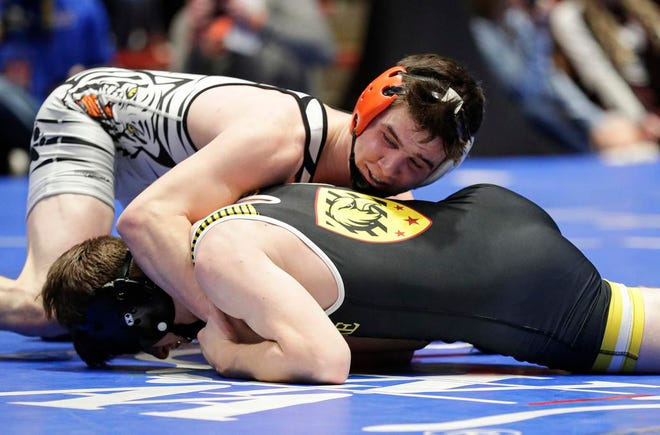 Stratford's Max Schwabe wrestles Fennimore's Maximos Miles in the 132-pound weight class Saturday during their WIAA Division 3 semifinal team match in Madison. Schwabe won with a pin.