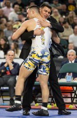 NJSIAA Individual Wrestling Championship boys finals take place at Boardwalk Hall. John Poznanski of Colonia wins the state title at 182lbs by defeating Luke Rada of Colts Neck.      Atlantic City, NJSaturday, March 7, 2020