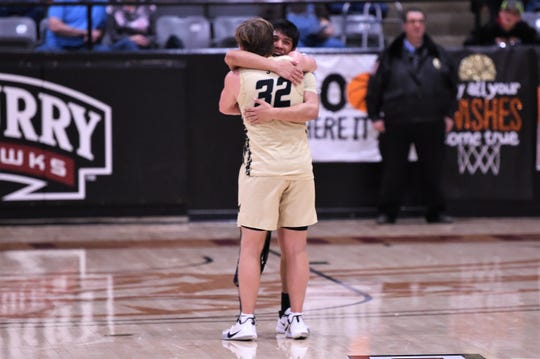 Jayton's Aaron Hernandez (3) hugs Tye Scogin (32) after winning the Region II-1A final 49-36 against Paducah at McMurry's Kimbrell Arena.