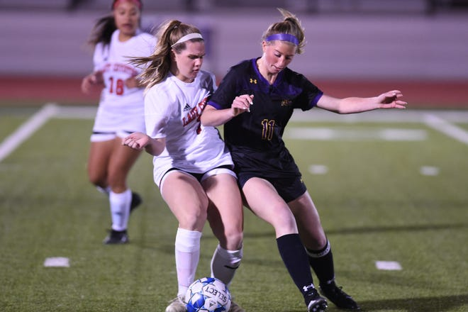 Wylie's Shaelyn Ward (11) holds off a Wichita Falls High defender during a March 6 game at Bulldog Stadium.