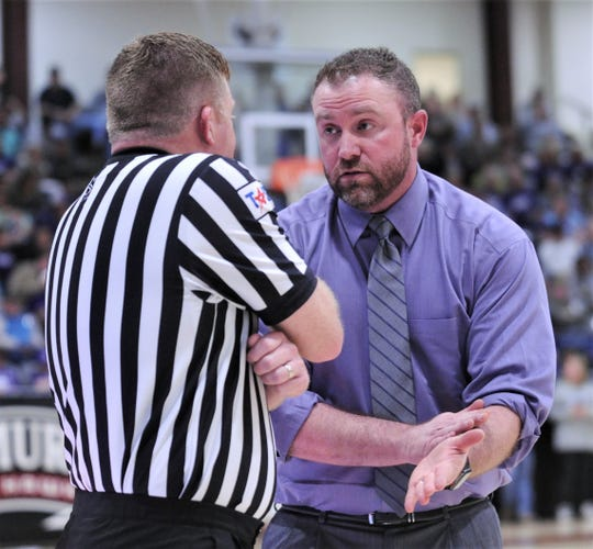 Sterling City coach Cody Slate, right, argues a call with an official during the Eagles' game against Paducah. Paducah won the Region II-1A semifinal game 51-36 on Friday, March 6, 2020, at McMurry's Kimbrell Arena in Abilene.